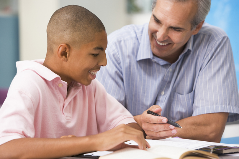 teacher talking to boy