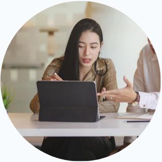 Woman looking at laptop screen