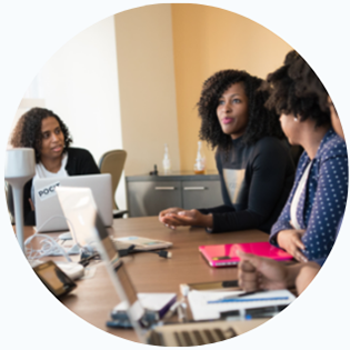 Three women at a conference table